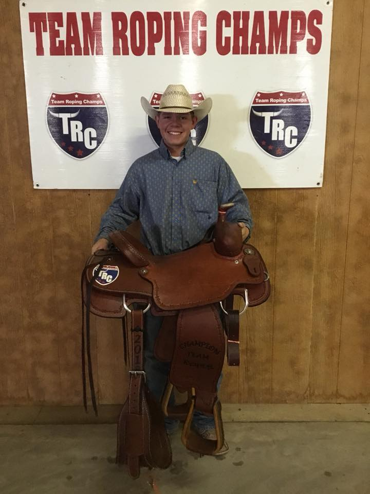 TRC High Point Saddle Winner Zant Zamora recieves a Scott Thomas Custom Trophy Saddle